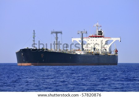 A large, ocean-going oil tanker ship at anchor. - stock photo