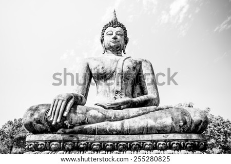 A large of Thai buddha in the old temple in Thailand with black and white color