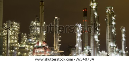 A large oil-refinery plant at night - stock photo