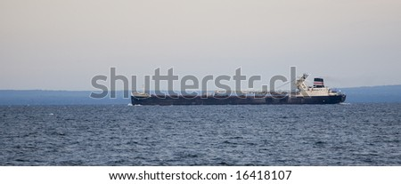 A large ore ship on the Great Lakes. - stock photo