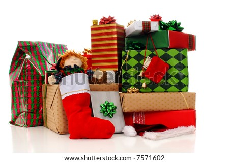 A large pile of colorfully wrapped Christmas gifts, isolated on white.