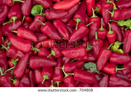 A large pile of red jalapeno chili peppers - stock photo