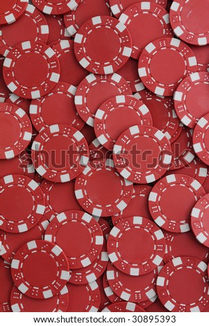 A large pile of red poker chips
