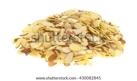A large portion of sliced almonds isolated on a white background. - stock photo