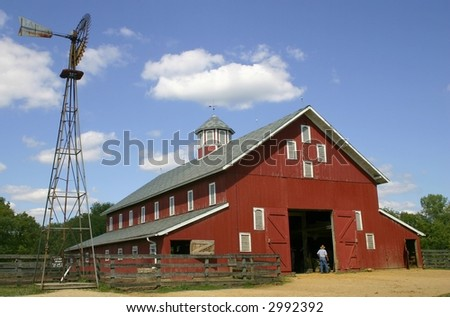 A large red barn - stock photo