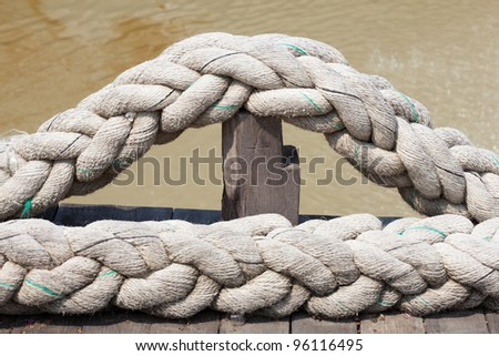 A large rope. Is the pile on the floor.
