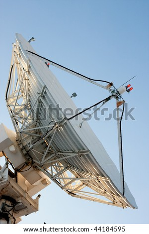 A large satellite dish for telecommunications industry aimed into space - stock photo