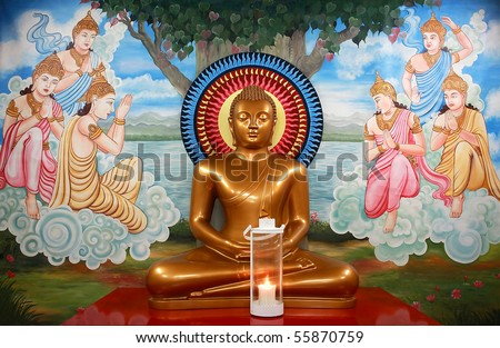 A large sculpture of a Buddha bright yellow color of gold, Sri Lanka - stock photo