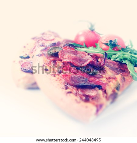 A large slice of American Hot pizza processed in the popular Instagram image style creating a retro and authentic look. Ideal for a trendy bistro or restaurant menu design. Copy space. - stock photo