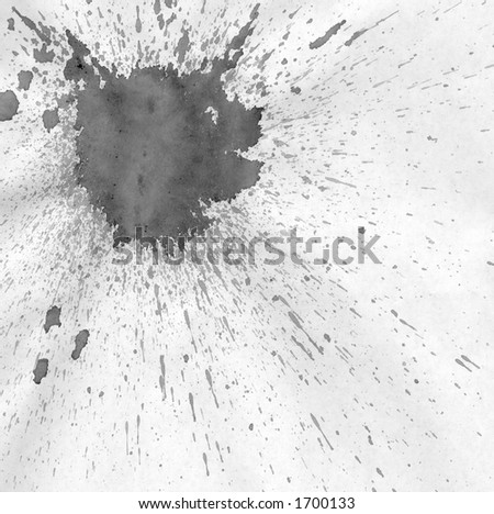 a large splash of ink on paper. - stock photo