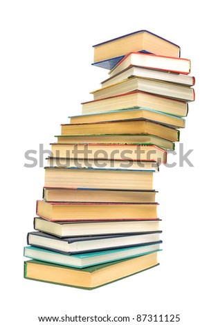 a large stack of books isolated on white background close-up