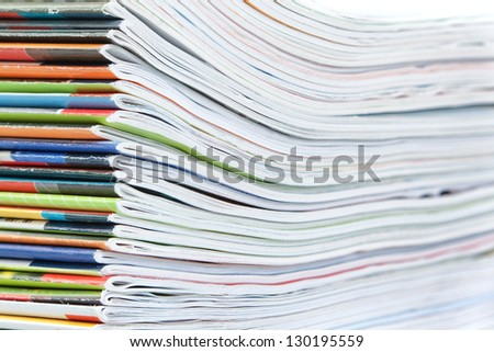 A large stack of colorful magazines. Close-up. - stock photo