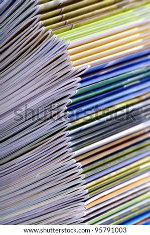 A large stack of magazines piled high