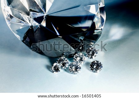 A large stone with smaller stones. - stock photo