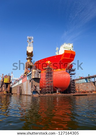 A large tanker repairs in dry dock. Shipyard Gdansk, Poland. - stock photo