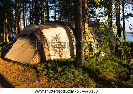 a large tent in the woods