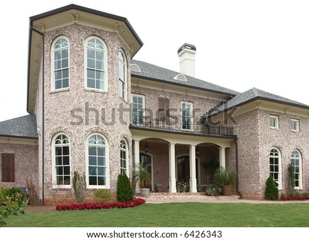 A large upper-income class brick home. - stock photo