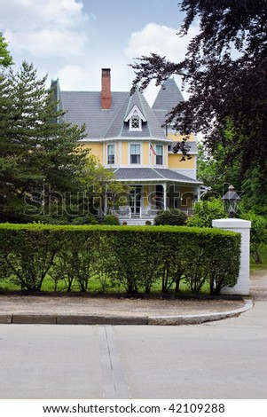 A large Victorian style home with classic architecture. - stock photo