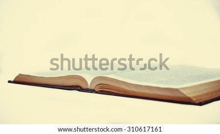 a large volume of the book lies on a white background
