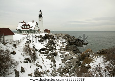 A large wreath is hung on Portland Head lighthouse in Maine to celebrate the holiday season. Portland light is the oldest beacon in Maine. - stock photo