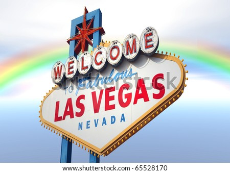 A Las Vegas sign with a beautiful rainbow in the background