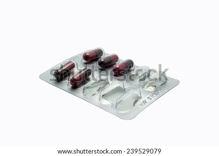 a last capsule of drug in package on white background - stock photo