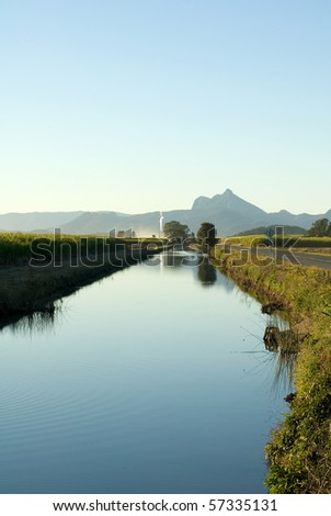 A late afternoon irrigation canal scene adjacent to a Sugar Cane field, near Mt Warning, NSW, Australia - stock photo