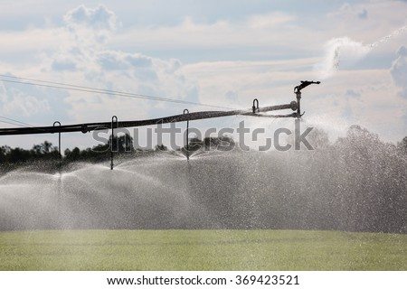 A Lateral Move Irrigation System, sometimes called a Linear Move, Wheelmove or Side Roll System, irrigating crops in Australia. These systems are often 500 meters to 1000 meters long. - stock photo