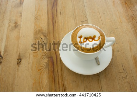 A Latte Coffee art on the wooden desk.A cup of coffee,coffee Art. - stock photo