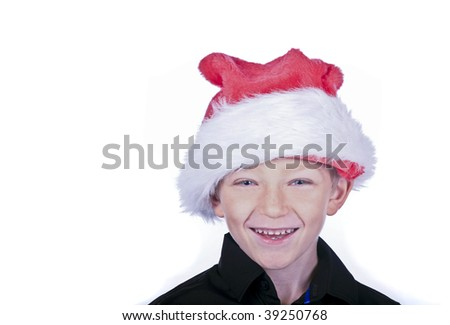 a laughing blonde boy in a santa hat