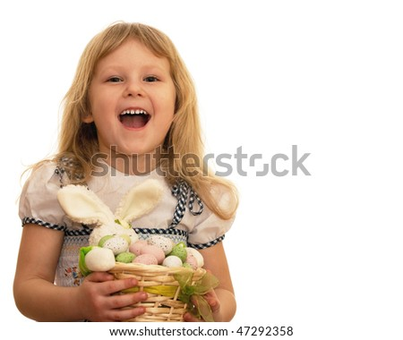 A laughing girl is holding a basket with Easter eggs and rabbit; isolated on the white background - stock photo