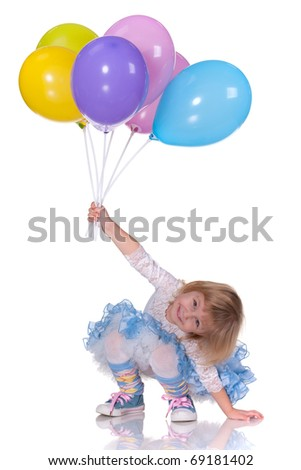 A laughing kid in blue is playing with balloons; isolated on the white background - stock photo