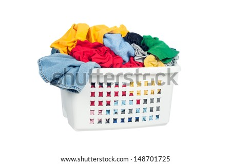 A laundry basket full of dirty clothes ready to be washed during daily chores. - stock photo
