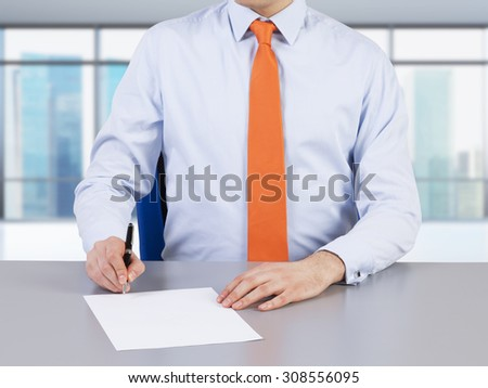 A lawyer and contract signing process. Singapore view on the background. - stock photo