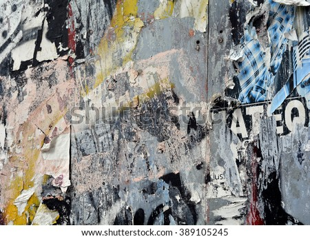 a layered texture background of torn posters and spray paint - stock photo