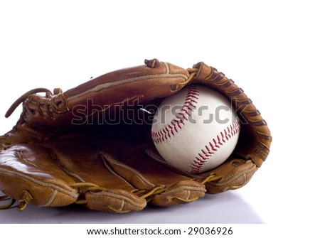 A leather baseball glove and a baseball on a white background with copy space
