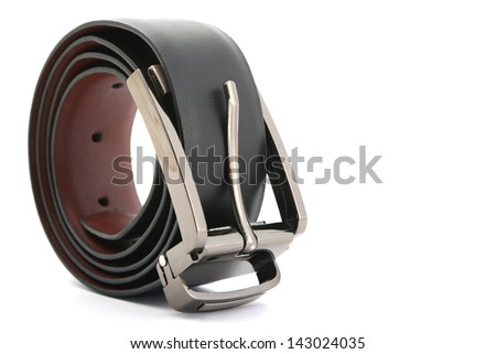 A leather belt with a metal buckle on white background. - stock photo