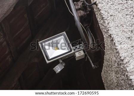 A LED spotlight on the garage - stock photo