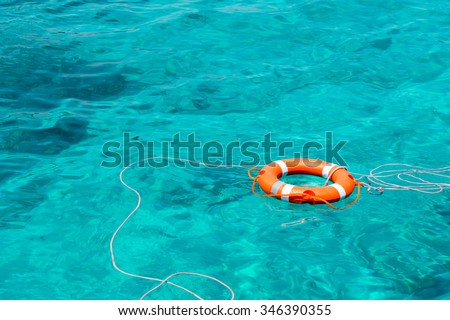 A life buoy in the sea - stock photo