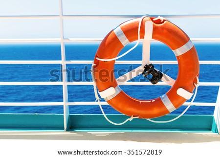 A life buoy on a cruise ship - stock photo
