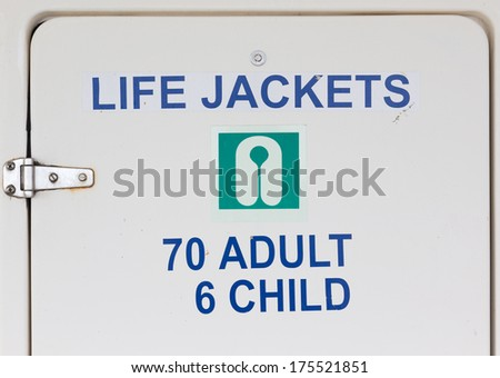 A Life Jackets Sign on a closet holding life jackets - stock photo