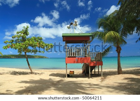 A lifeguard post stands in front of a calm aqua bay at Seven Seas Beach near Fajardo, Puerto Rico