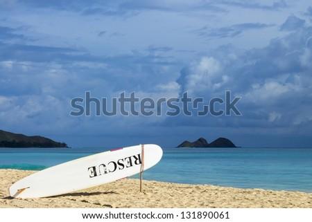 A lifeguard rescue board on the beach - stock photo