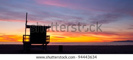 A lifeguard tower at sunset on a beach in Los Angeles, California. - stock photo