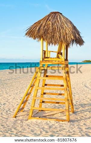 A lifesaver observation chair on a beautiful tropical beach near sunset - stock photo