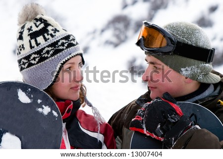 A lifestyle image of two young adult  snowboarders (series Sport, Extreme, Mountain, Horses and Teenagers) - stock photo