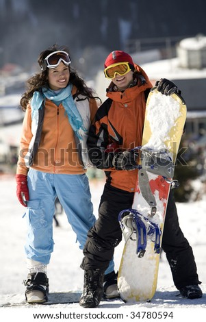 A lifestyle image of two young adult  snowboarders, Tien Shan, Asia - stock photo