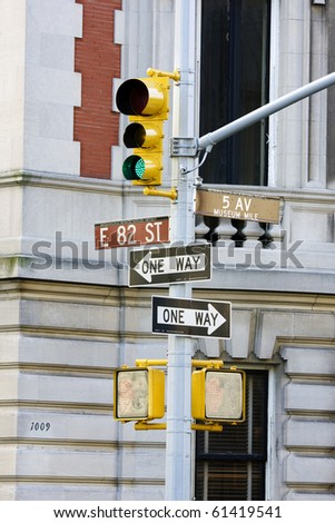 A light and a sign pointing to 5th avenue - stock photo