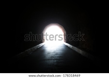 A light at the end of the tunnel. A concept image representing hope, faith, endurance, perseverance, depression, and similar ideas. - stock photo