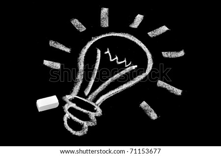 a light bulb drawn in blackboard symbolizing the concept idea - stock photo